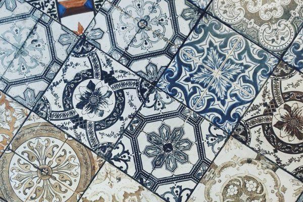 Various blue tiles on a floor