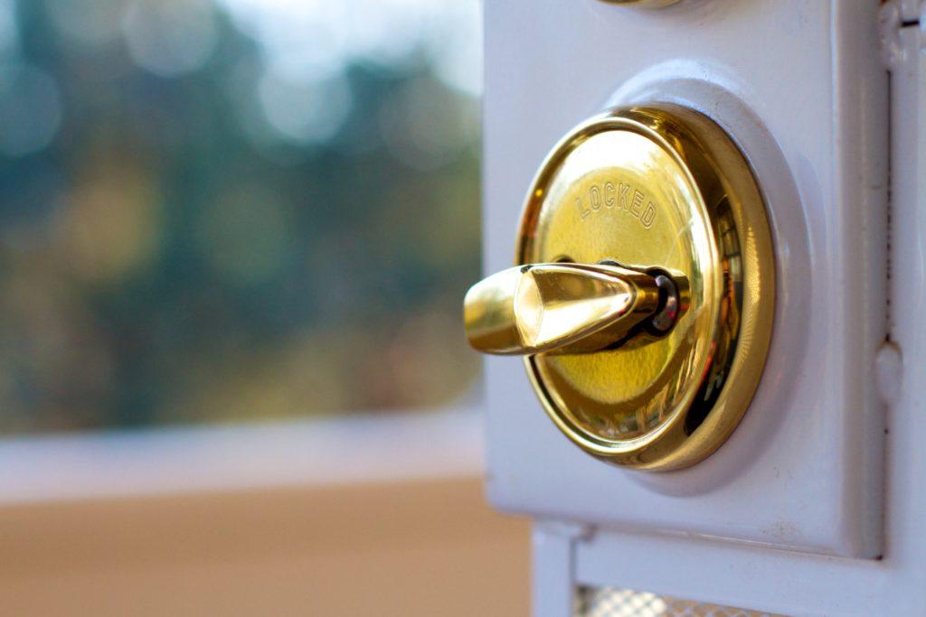 Door opening to look outdoors, lock is shown in the unlocked position