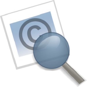 Magnifying glass on top of page with copyright logo (letter C in a circle)